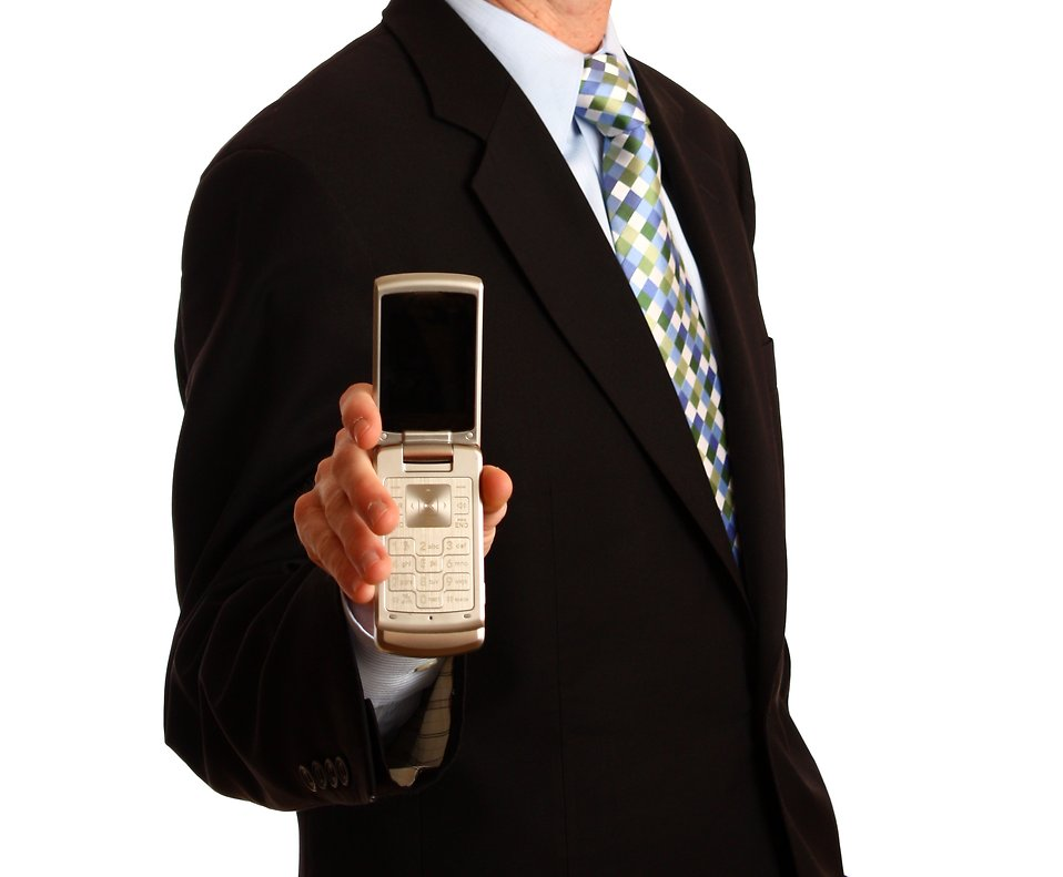 13248-a-young-businessman-holding-a-cell-phone-pv